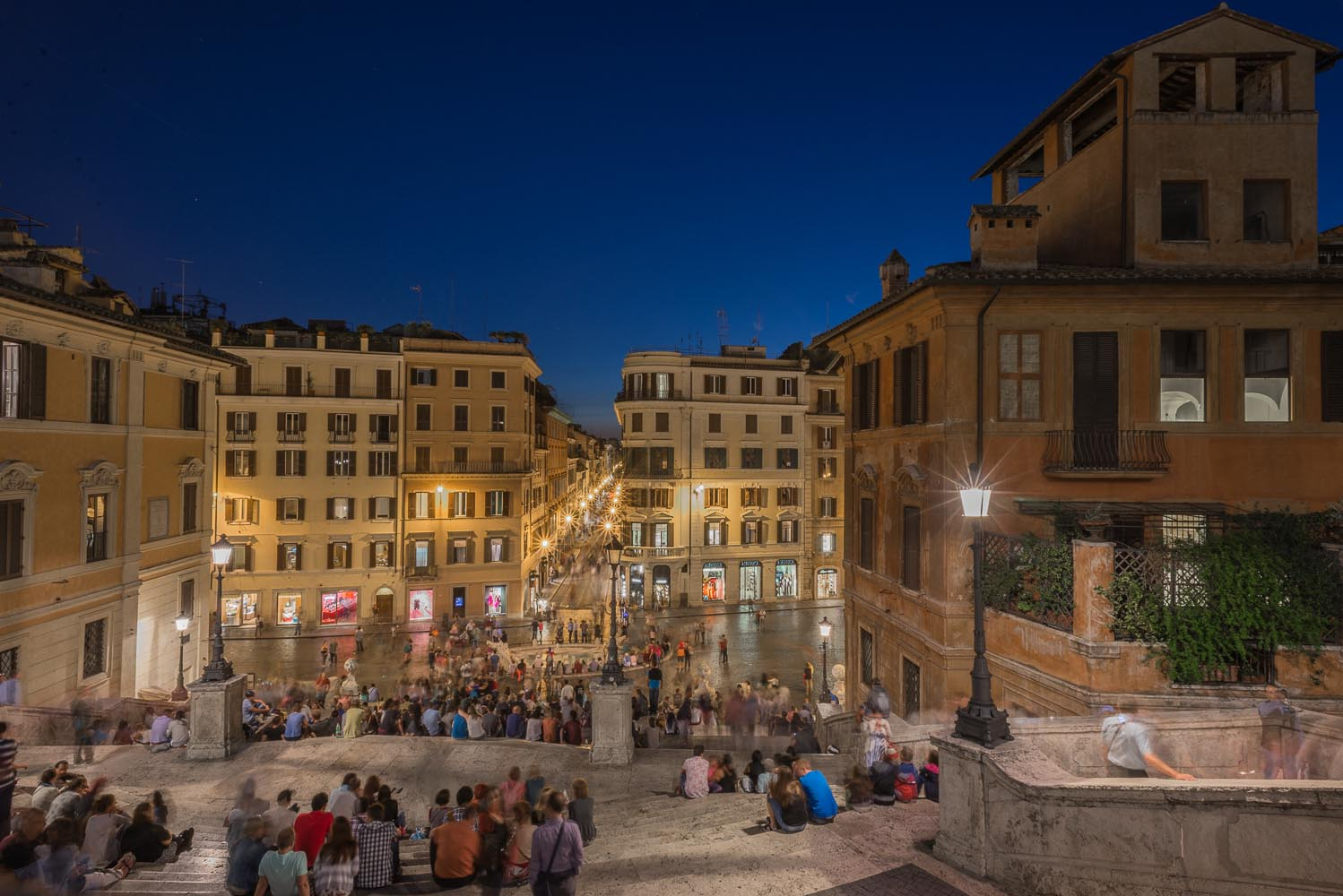The busy Piazza Spagna at night, Rome, Italy